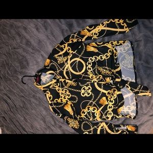 Black long sleeve shirt with gold chain design